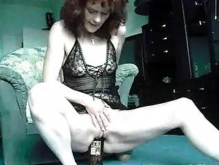 Extreme amateur fucks a whiskey bottle and cucumbe